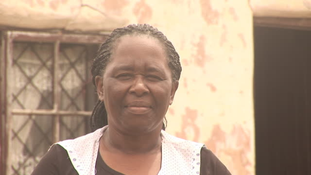 African lady looking at Camera 3- HD & PAL2