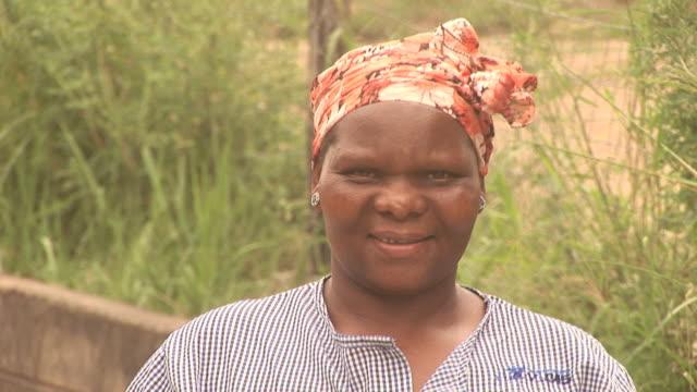 African lady looking at Camera - HD & PAL