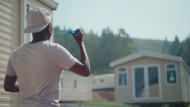 african male blowing bubbles