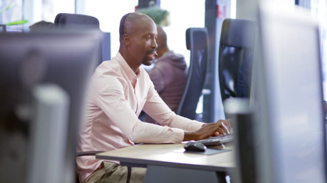 ld african male call center agent providing customer support - headset stock videos & royalty-free footage
