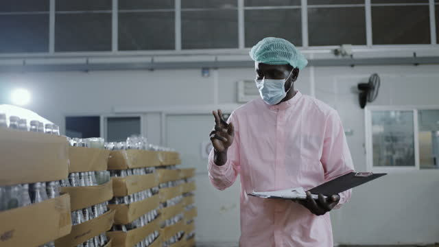 african male controllers examining in bottling plant - surgical cap stock videos & royalty-free footage