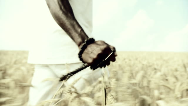 hd slow-motion: african man blessing in wheat - religion stock videos and b-roll footage