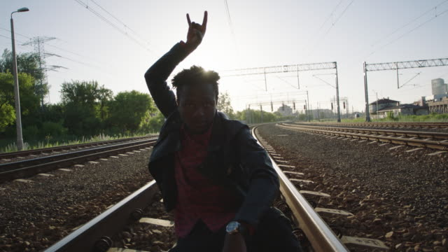 african man gesturing on the railroad truck. rock and roll style. - music video stock videos & royalty-free footage