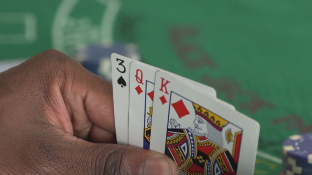 mcu african man looking at playing cards/ cape town/ south africa - spade stock videos & royalty-free footage