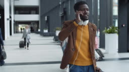African Man Talking on Phone in Airport