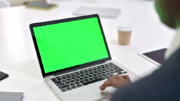 African Man working on Laptop with Chroma Key Screen