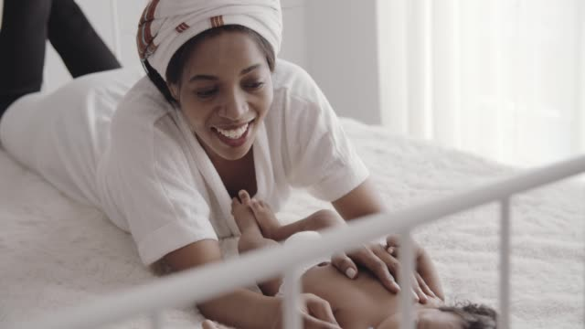 african mom and baby boy(2-5 months) comfort and relaxing together - 2 5 months stock videos & royalty-free footage