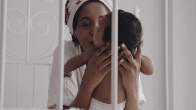 african mother holding her baby son - 2 5 months stock videos & royalty-free footage
