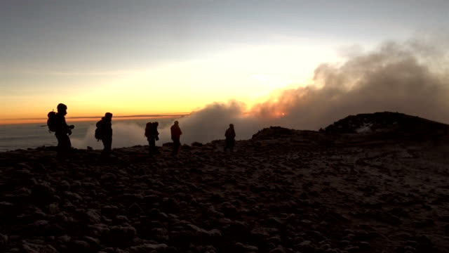 African mountains sunset. Climbing to a base camp. Expedition
