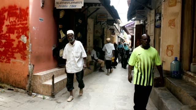 african muslims walking in alleys/ Zanzibar