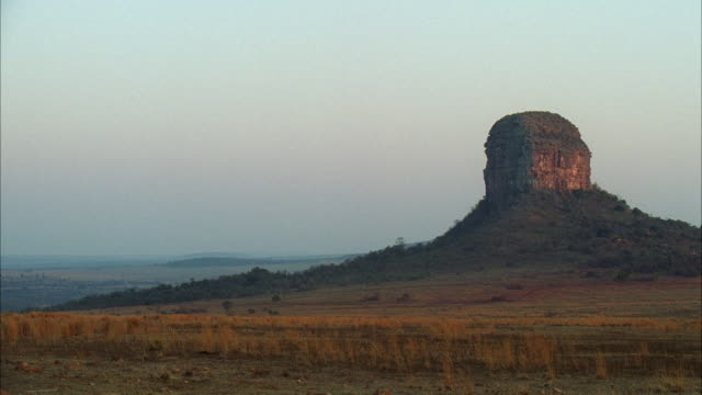 ws african plains with tall mountain butte / unspecified - butte rocky outcrop stock videos and b-roll footage