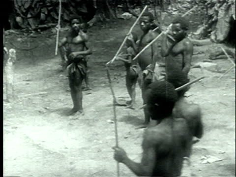 1939 WS PAN African Pygmies practicing hunting techique by attempting to spear an object swinging on a rope held by another Pygmy man/ Africa/ AUDIO