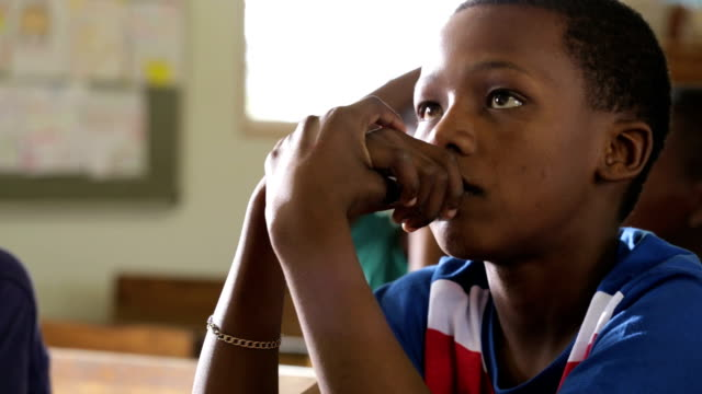african school boy figuring out the answer - africa stock videos & royalty-free footage