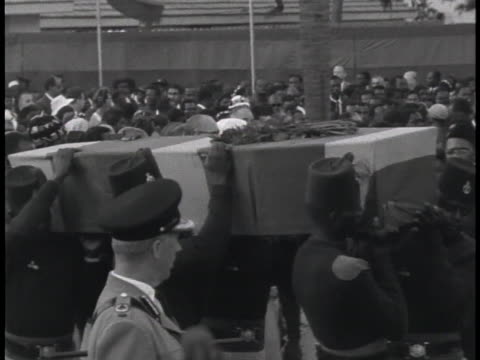 african soldiers carry the casket of george padmore, political advisor to ghana's prime minister dr. kwame nkrumah, to its viewing place. - 1950 1959 stock videos & royalty-free footage