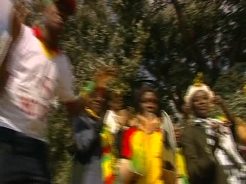 african supporters dance and chant for ghana's football team during the 2010 world cup south africa - fußballweltmeisterschaft 2010 stock-videos und b-roll-filmmaterial