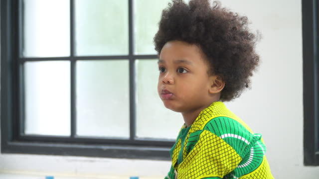 african thai boy waiting for continuing eating cookie - afro stock videos & royalty-free footage