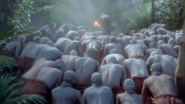 african tribesmen wave their arms, kneel, and dance as part of a ceremony. - praying stock videos & royalty-free footage