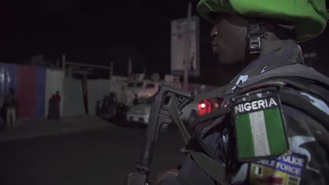 african union police from various parts of africa run a nighttime checkpoint in mogadishu. includes images of frisking, checking tac tacs and... - camouflage stock videos & royalty-free footage