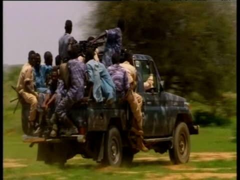 vidéos et rushes de african union troops drive through village in military jeep darfur; 18 aug 05 - guerre civile