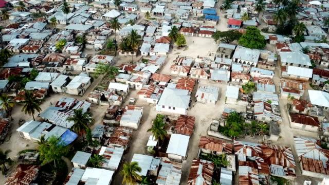 African village shanty town -huts and shacks/Aerial looking down, Zanzibar