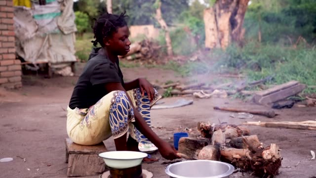 african woman cooking food in rural village, malawi, africa - hungry stock videos & royalty-free footage