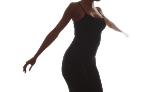 african woman in black dancing on white background - gymnastikanzug stock-videos und b-roll-filmmaterial