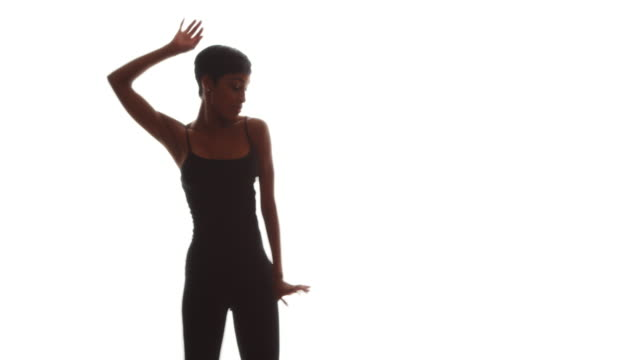 african woman in black leotard dancing on white background - leotard stock videos & royalty-free footage