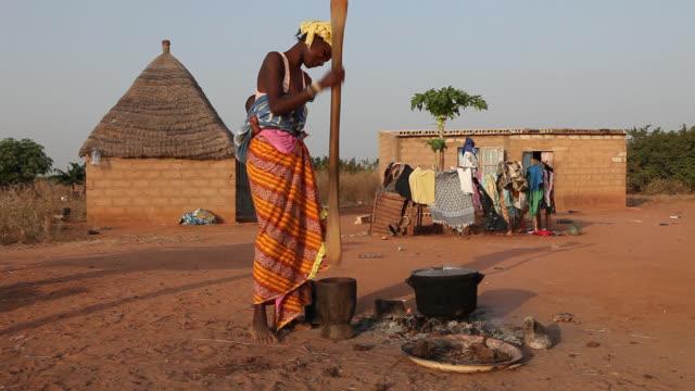 african woman making food - senegal stock videos & royalty-free footage