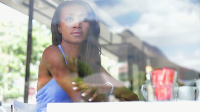 african woman waiting in coffee shop for her man - forgiveness stock videos & royalty-free footage