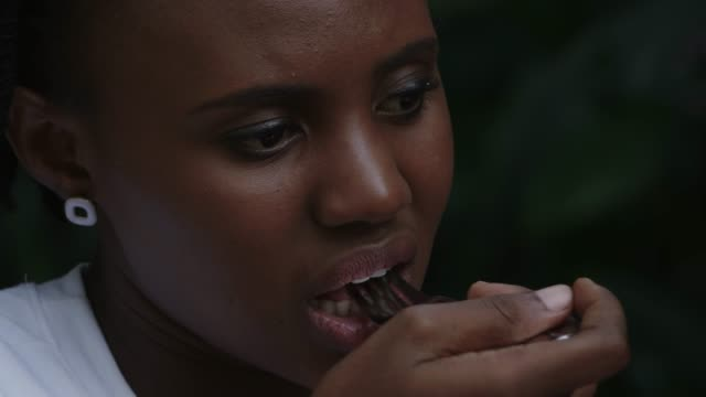 african women eating steak with fork - masticare video stock e b–roll