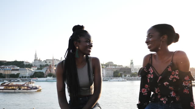 african women on holiday - enjoying sunset in the city - whispering stock videos & royalty-free footage
