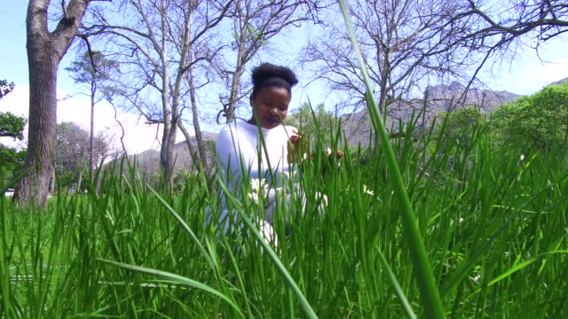 african women smelling the flowers - hay fever stock videos and b-roll footage