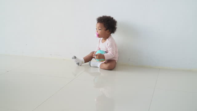 africana baby girl having a world in her hand with innocence in the living room, concept of preschool, childhood, playing of a sibling. - 2 3 years stock videos & royalty-free footage