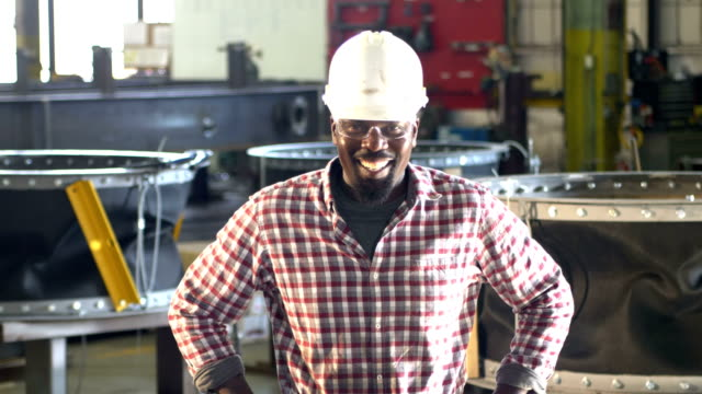 african-america man in metal fabrication plant, hardhat - construction worker stock videos & royalty-free footage
