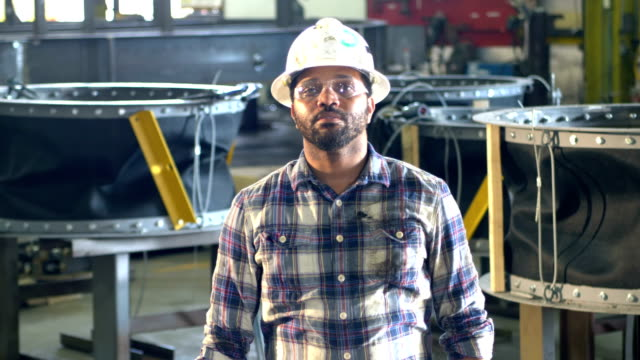 african-america man in metal fabrication plant, hardhat - hard hat stock videos & royalty-free footage