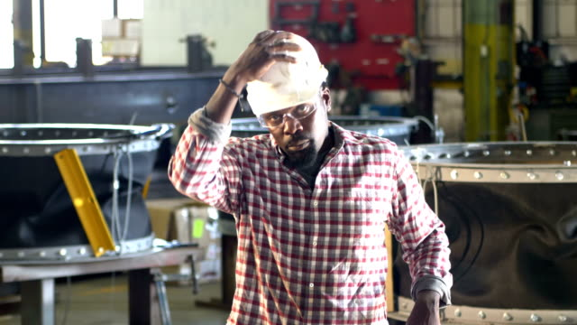 african-america man in metal fabrication plant, hardhat - safety glasses stock videos & royalty-free footage