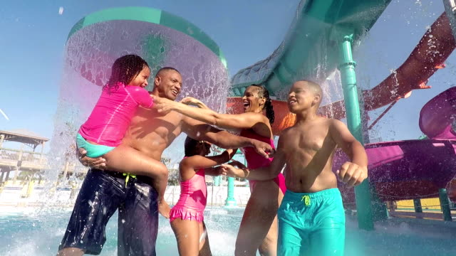 African-American and Hispanic family at water park