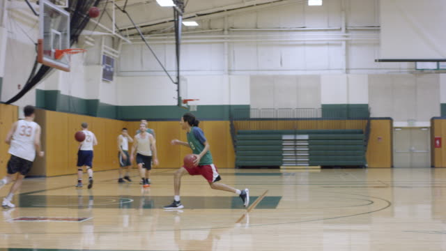 african-american basketball player running a drill - sports hall stock videos & royalty-free footage