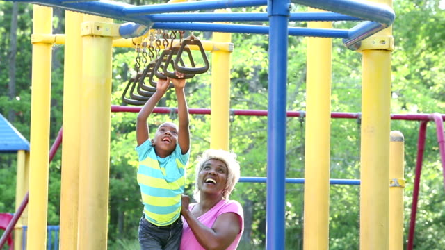 african-american boy and grandmother on playground - jungle gym stock videos and b-roll footage