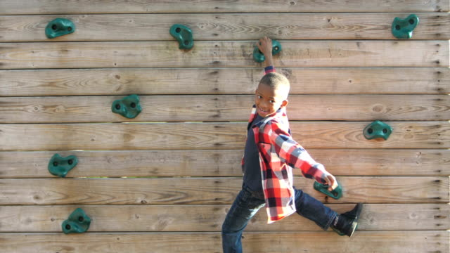african-american boy on climbing wall - climbing wall stock videos & royalty-free footage
