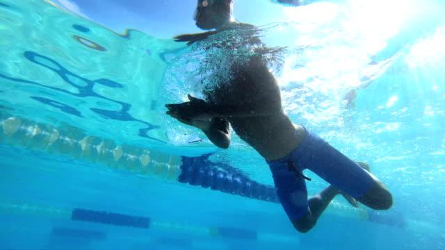 African-American boy swimming breaststroke