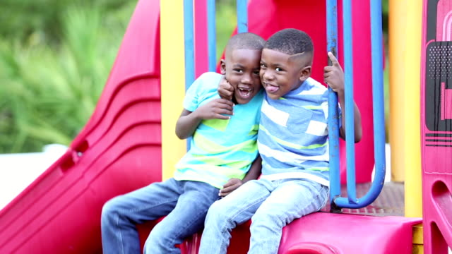 african-american brothers climbing on playground slide - playground stock videos & royalty-free footage