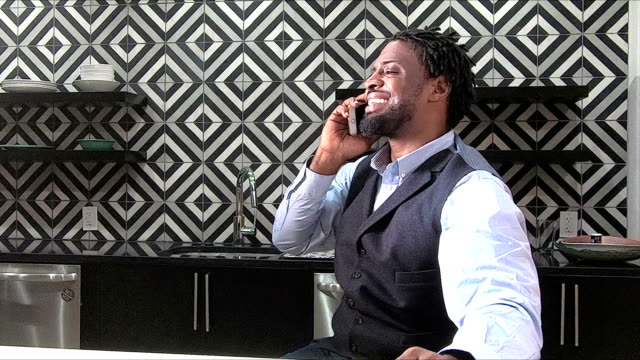 african-american businessman making phone call - one mid adult man only stock videos & royalty-free footage