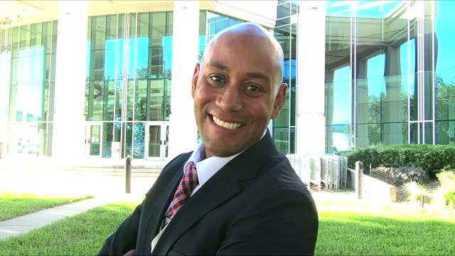 African-American businessman standing outdoors