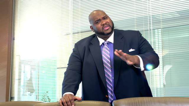 african-american businessman talking in board room - 40 44 years stock videos & royalty-free footage