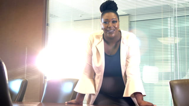 African-American businesswoman board room, smiling