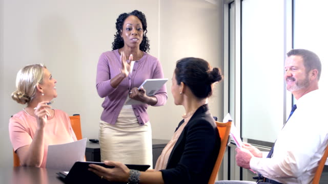 african-american businesswoman giving presentation - small group of people stock videos & royalty-free footage