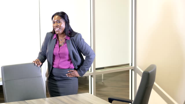 african-american businesswoman in boardroom - hand on hip stock videos & royalty-free footage
