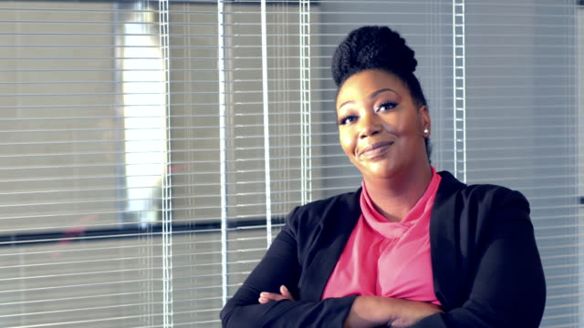 African-American businesswoman standing in board room