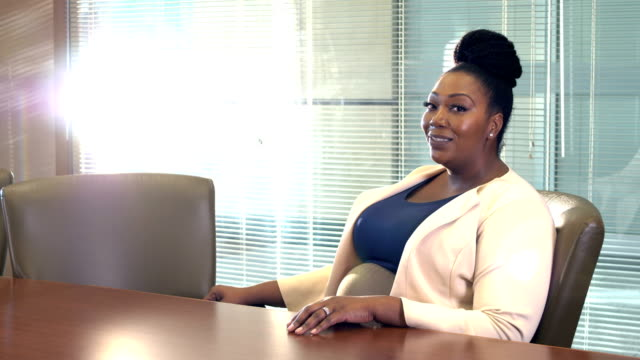 african-american businesswoman talking in board room - voluptuous stock videos & royalty-free footage